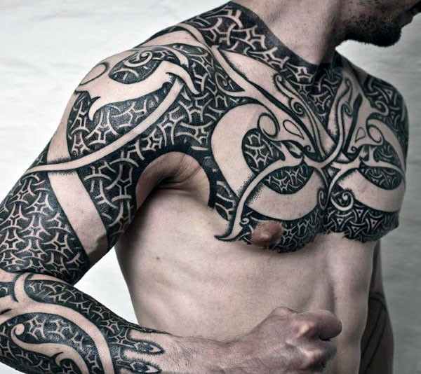 Awesome black and white detailed armor like tattoo on sleeve and whole chest