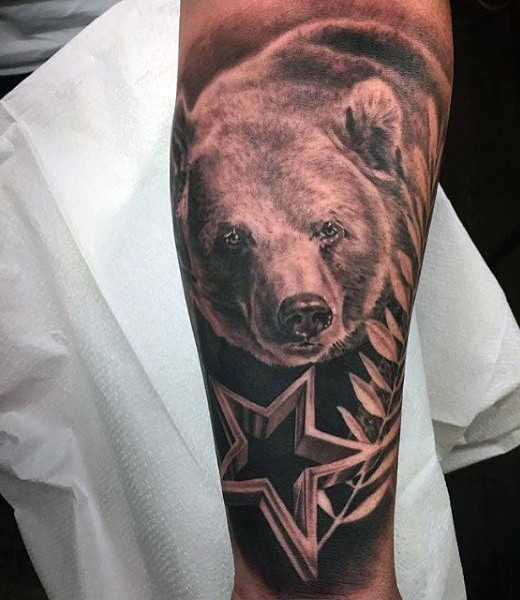 Awesome black and white realistic bear with star tattoo on arm
