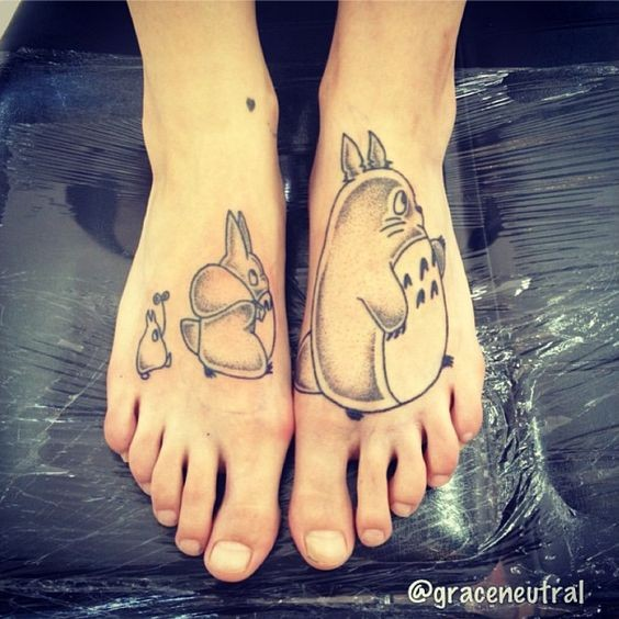 Awesome black and white various Asian cartoon funny monsters tattoo on feet