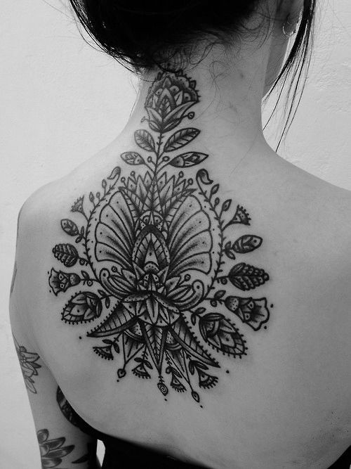 Awesome black gray patterns tattoo on upper back