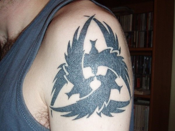 Awesome black ink crows irish tattoo on shoulder