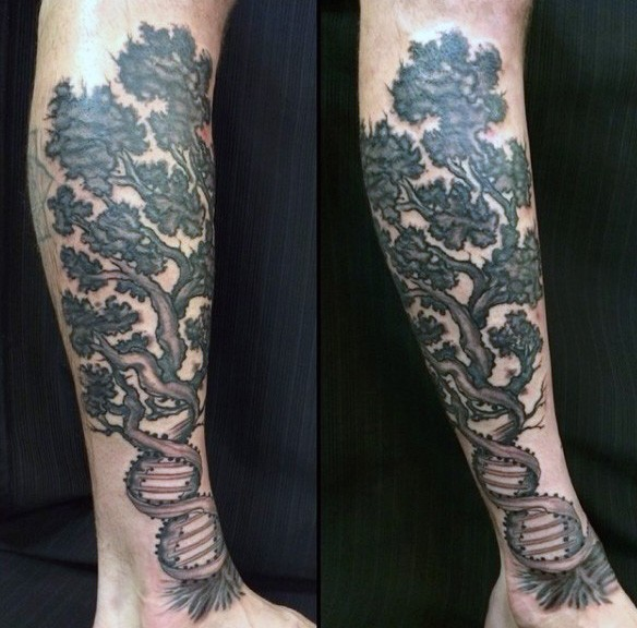 Awesome black ink DNA shaped big tree tattoo on leg