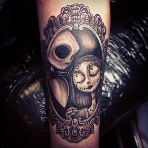 Awesome black ink monster cartoon heroes portrait tattoo on arm