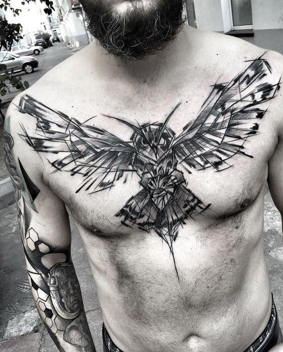 Awesome blackwork style chest tattoo painted by Inez Janiak of flying owl