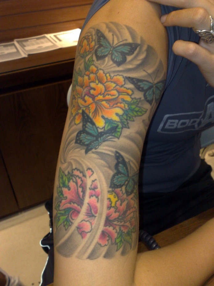 Awesome butterfly sleeve tattoo with pattern