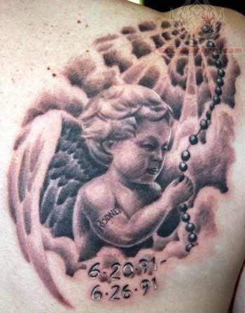 Awesome cherub baby memorial tattoo