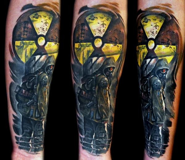 Awesome colored arm tattoo of Stalker emblem with man in gas mask