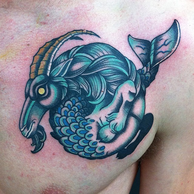 Awesome colored fantasy half goat half fish tattoo on chest