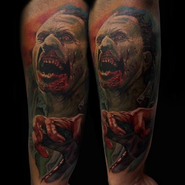 Awesome colored horror style forearm tattoo of creepy monster face
