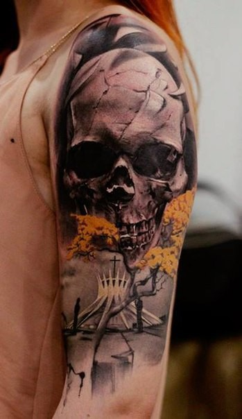 Awesome colored shoulder tattoo of human skull with strange church