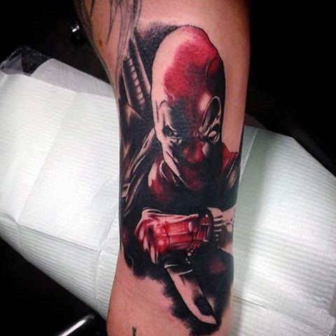 Awesome colored tattoo of angry Deadpool with small knife