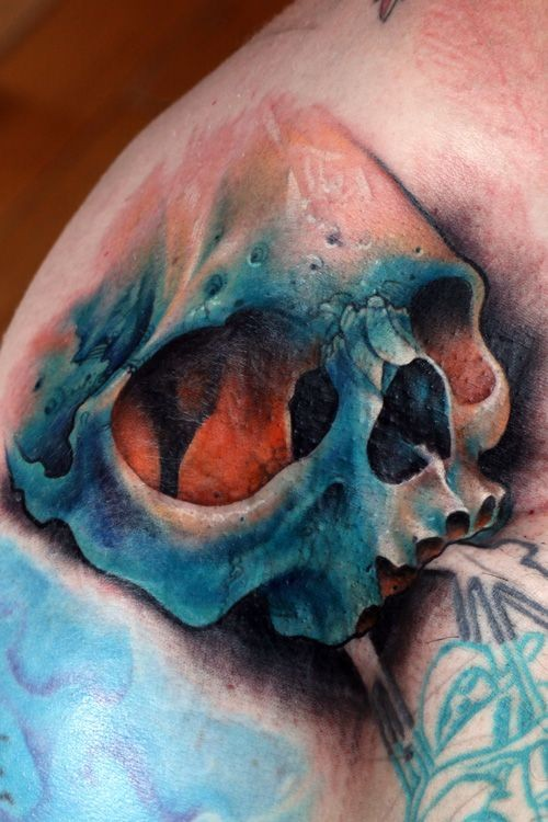 Awesome colorful realistic blue skull tattoo