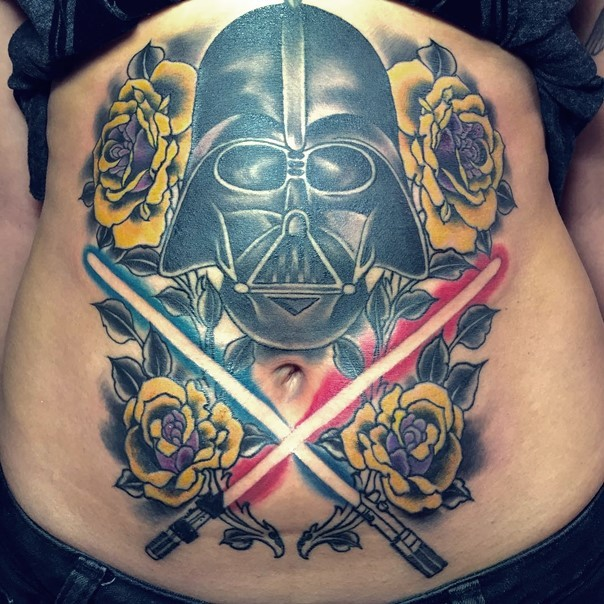 Awesome colorful Star Wars themed Darth Vaders helmet with crossed lightsabers tattoo
