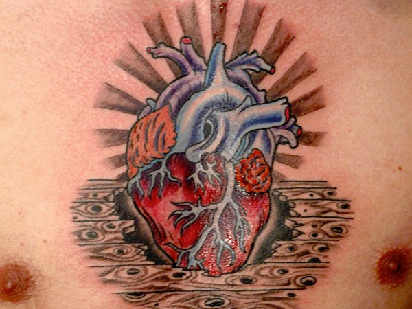 Awesome coloured heart tattoo on chest