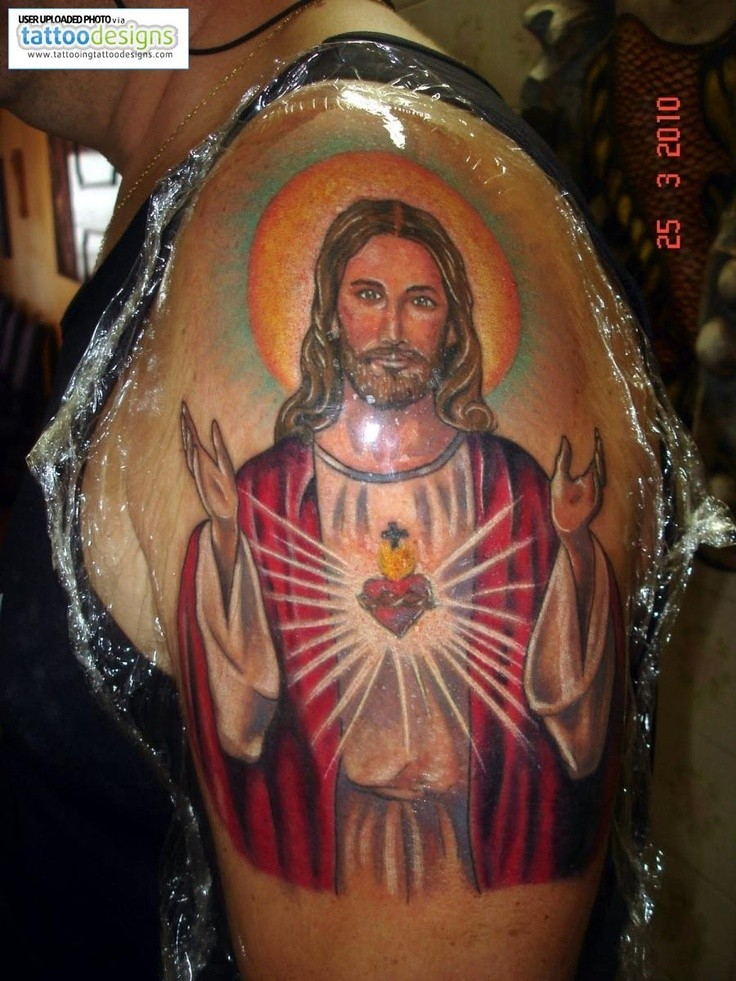 Awesome coloured jesus tattoo on shoulder