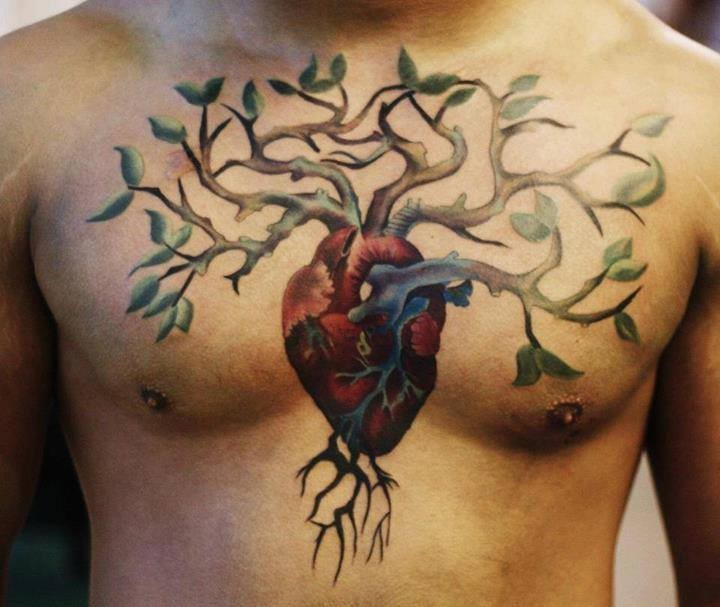 Awesome coloured tree grew from heart tattoo on chest