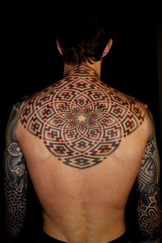 Awesome designed and colored big mystical ornament tattoo on upper back
