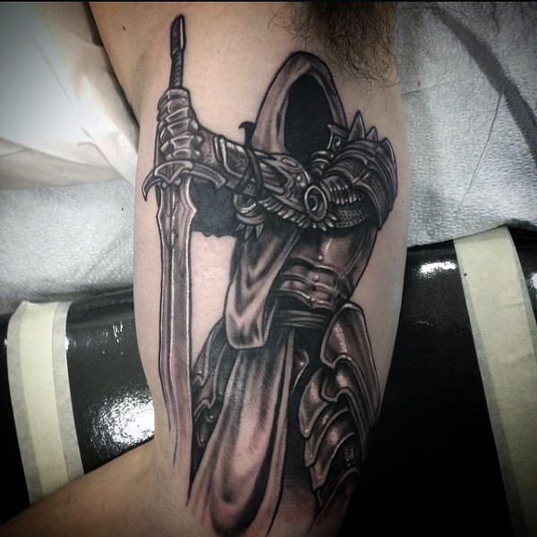 Awesome designed and detailed black and white fantasy mystic warrior with cool sword tattoo on arm