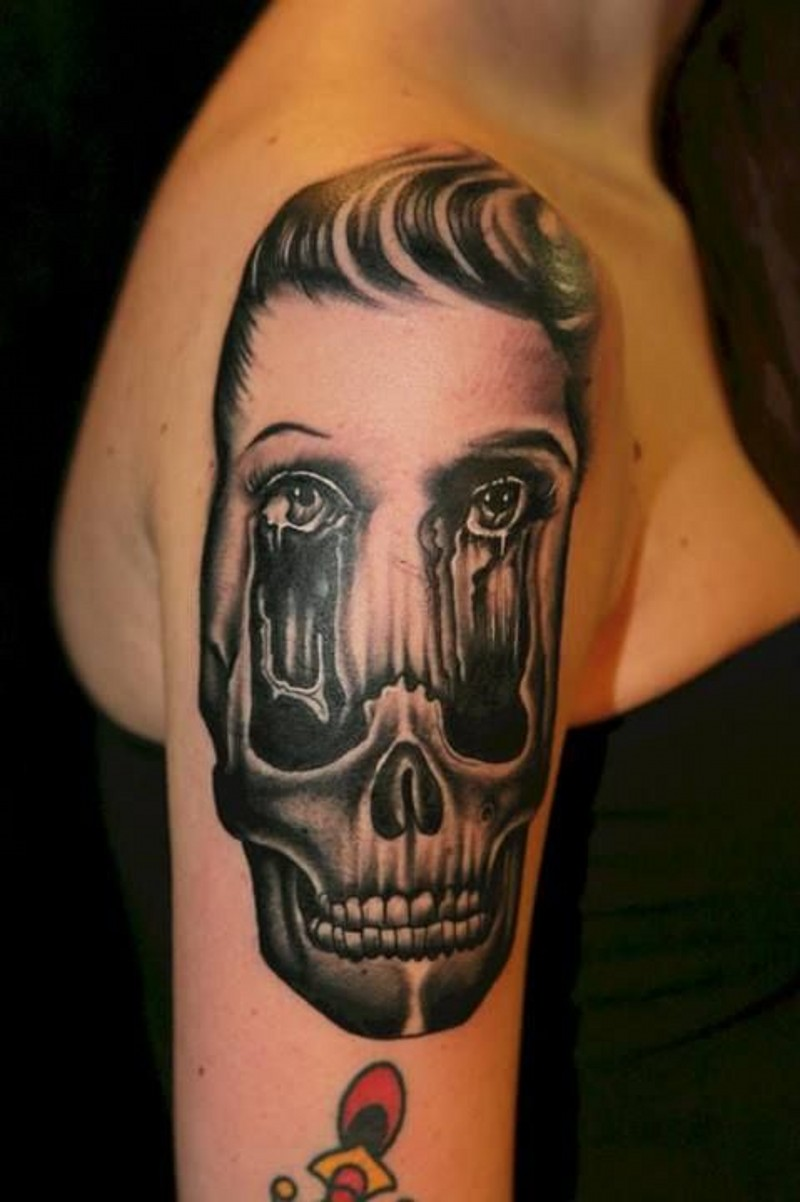 Awesome designed and painted black and white corrupted face with skull tattoo on arm