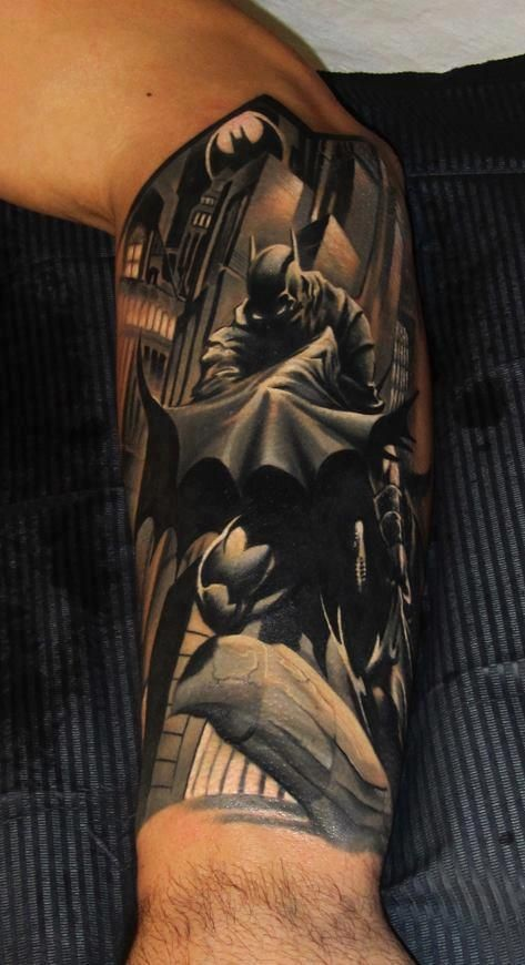 Awesome designed and painted colored Batman in city tattoo on arm