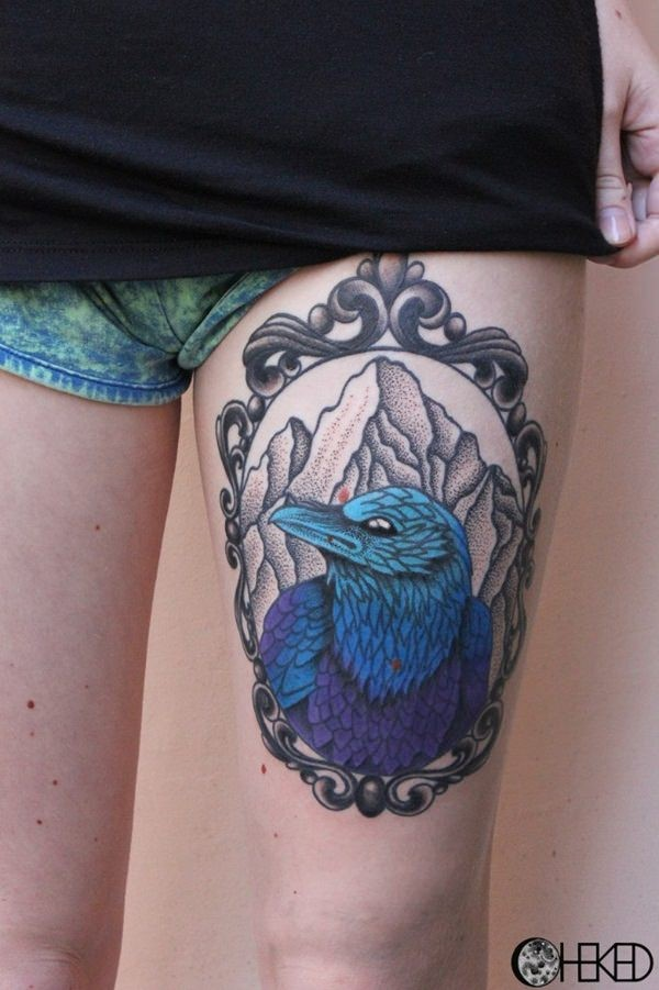 Awesome designed big thigh tattoo of interesting colored bird portrait