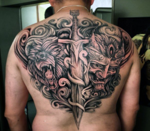 Awesome designed black and white fantasy demonic monster with bear and sword tattoo on upper back
