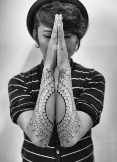 Awesome designed black and white tribal circle shaped tattoo on forearms