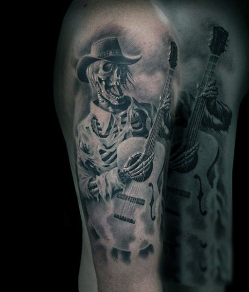 Awesome designed black and white western skeleton singer with guitar tattoo on arm