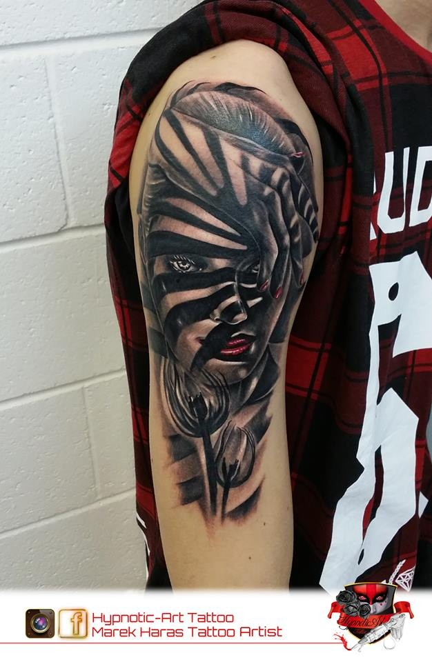 Awesome designed zebra style colored shoulder tattoo of woman face with flowers