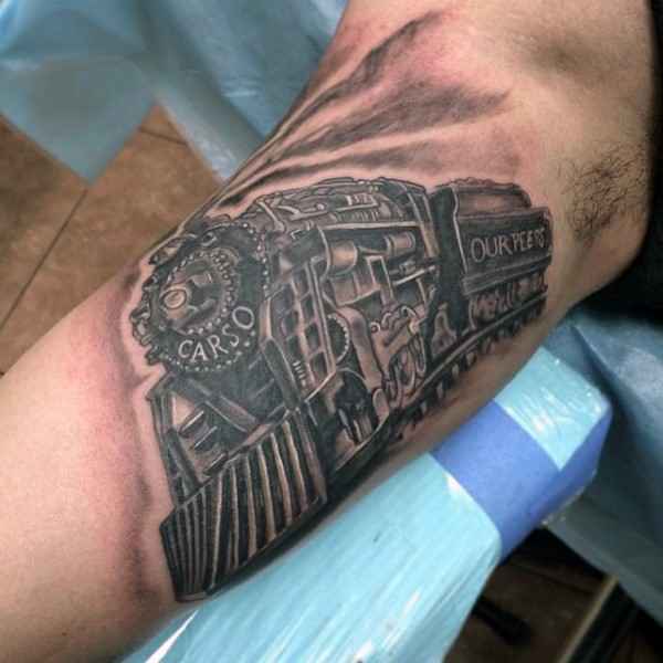 Awesome detailed big old western train tattoo on arm
