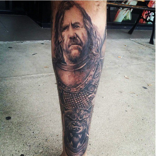 Awesome detailed black ink leg tattoo of medieval warrior