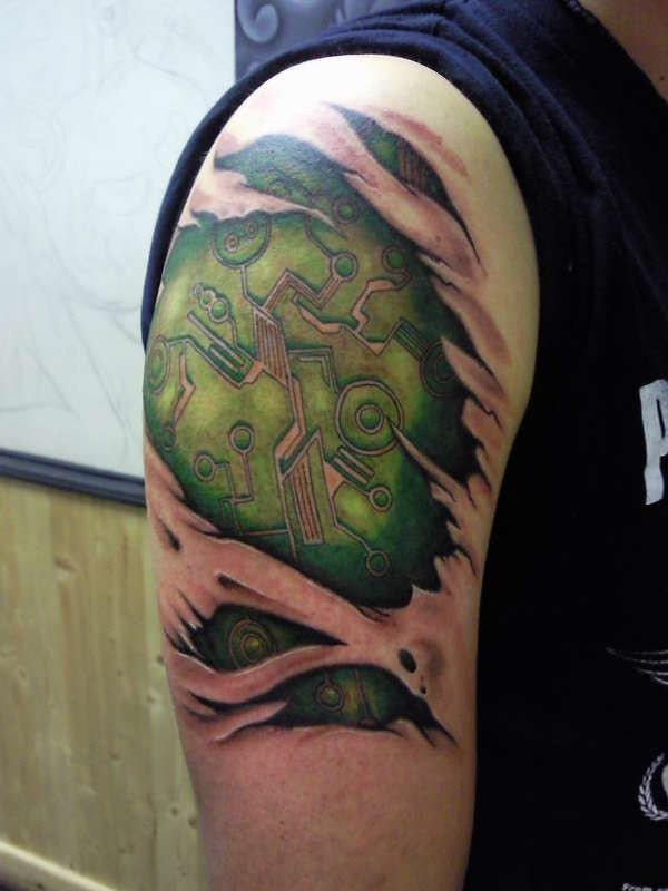 Awesome electronic circuit skin rip tattoo on shoulder