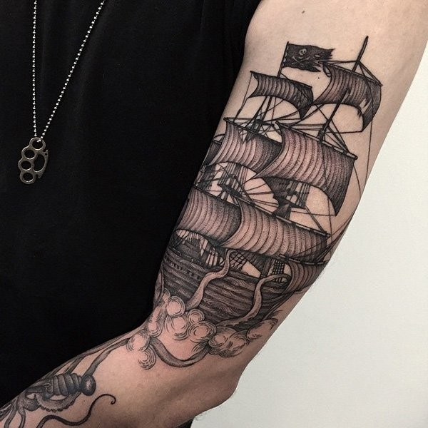 Awesome engraving style sleeve tattoo of big sailing ship with octopus