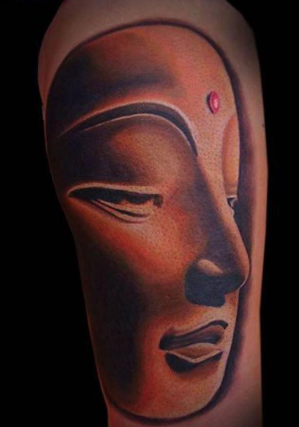 Awesome face of buddha tattoo