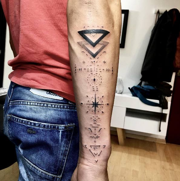 Awesome geometrical style black ink arm tattoo of various symbols and figures