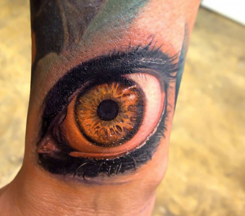 Awesome large very detailed arm tattoo of human eye