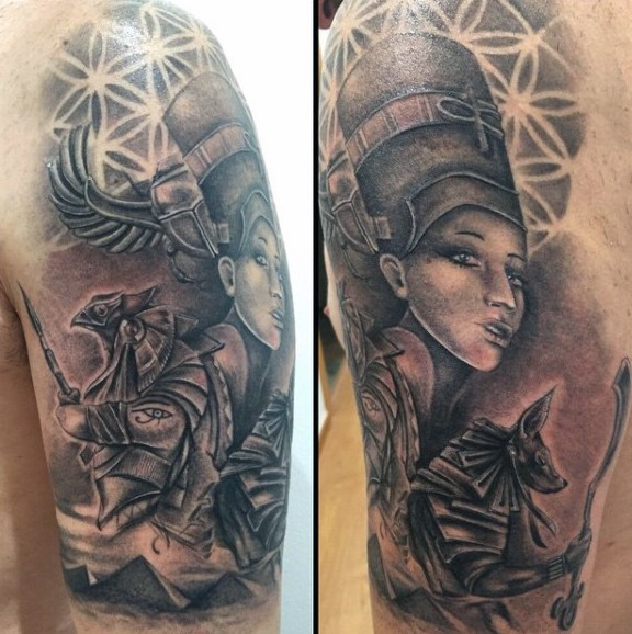 Awesome looking black and white Egypt gods tattoo on shoulder