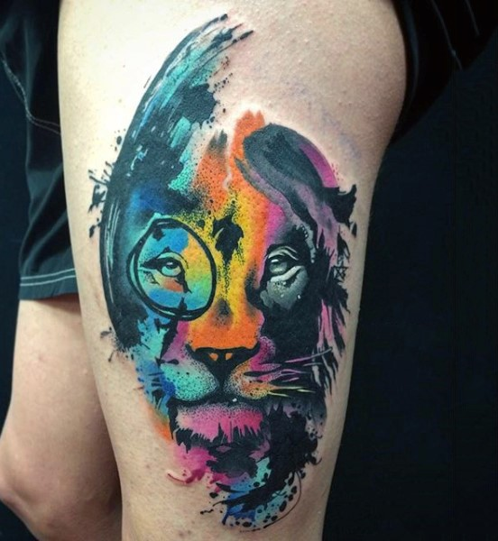 Awesome multicolored big lion face tattoo on thigh