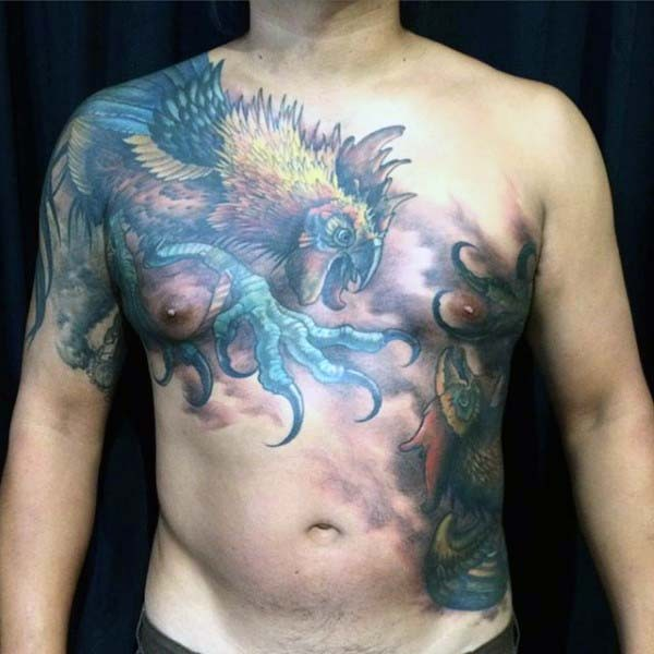 Awesome multicolored bog cock tattoo on upper back