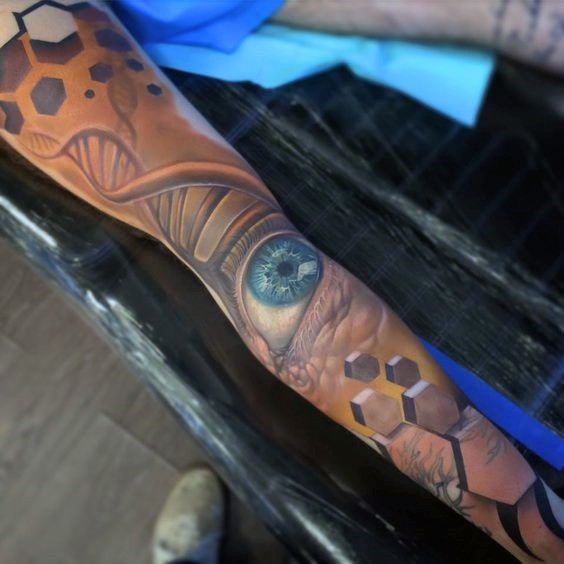 Awesome multicolored DNA with eye tattoo on sleeve
