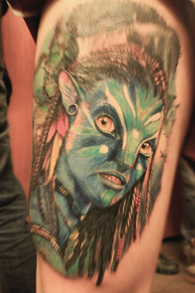 Awesome natural looking detailed Avatar woman portrait tattoo