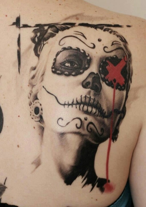 Awesome new school day of the dead tattoo on back