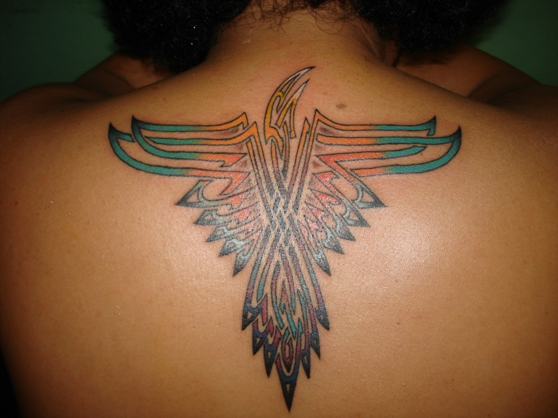Awesome nice colored upper back tattoo of tribal eagle