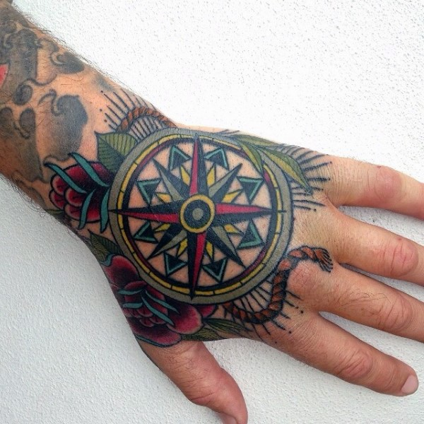Awesome old school style colored compass and red roses hand tattoo with rope