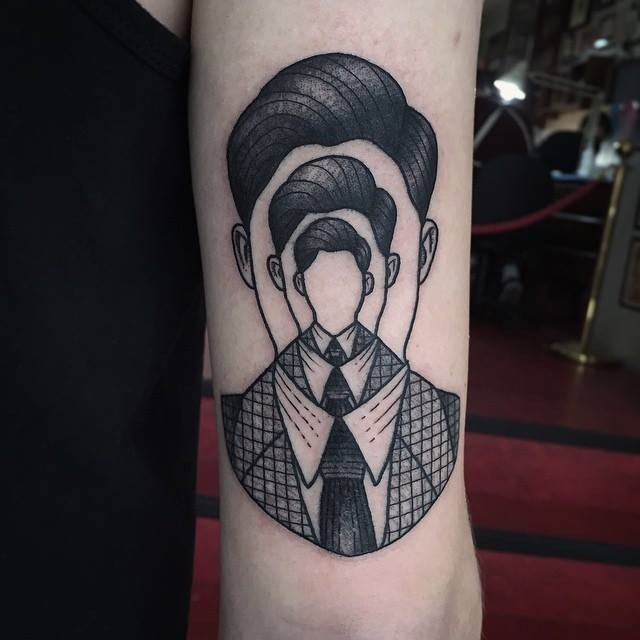 Awesome optic illusion like black ink man portrait tattoo on arm