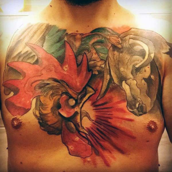 Awesome painted and colored bull and cock fight tattoo on chest