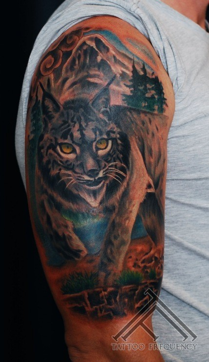 Awesome painted big wild life cat with yellow eyes tattoo on shoulder