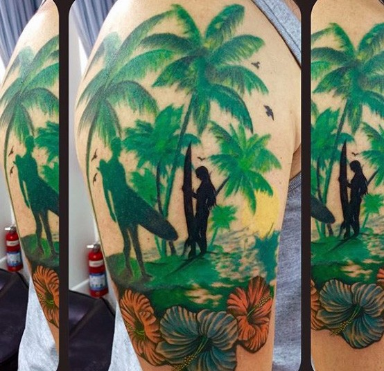Awesome painted colorful surfers with palm tree and flowers tattoo on shoulder