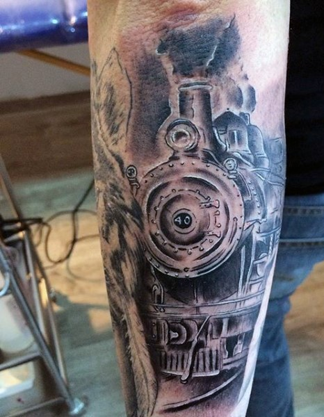 Awesome painted detailed big steamy train tattoo on arm