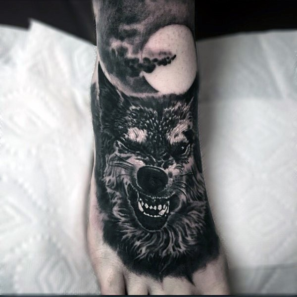Awesome painted evil wold with moon tattoo on foot